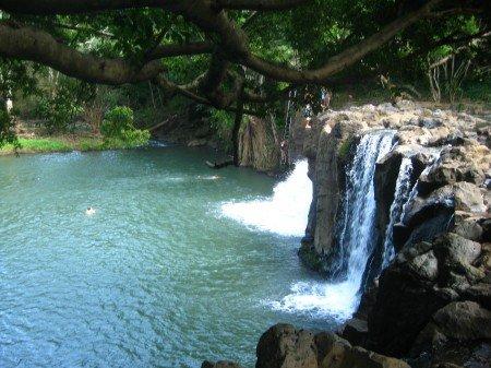 Best Hikes in Kauai - Waterfall on a backpacking trail in Kauai Hawaii.