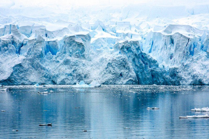 Iceberg collapsing in Antarctica seen from a cruise ship