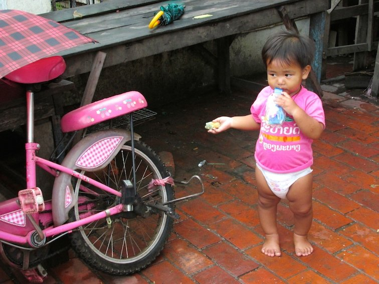 Luang Prabang Night Market Vendor Laos Child Baby Pink