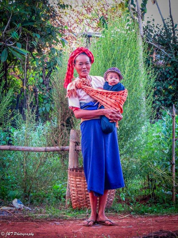 Myanmar farm woman with baby portrait