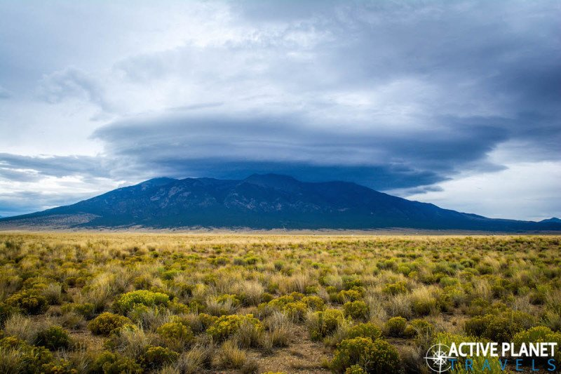Outdoor adventure, travel, sand dunes, sand boarding, sandboarding, Great Sand Dunes, National Park, Colorado, Mountain, Rain Cloud