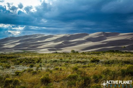 Outdoor adventure, travel, sand dunes, sand boarding, sandboarding, Great Sand Dunes, National Park, Colorado