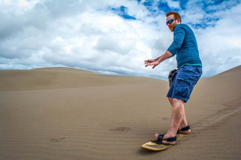 Outdoor adventure, travel, sand dunes, sand boarding, sandboarding, Great Sand Dunes, National Park, Colorado, Hiking, Desert, Liam
